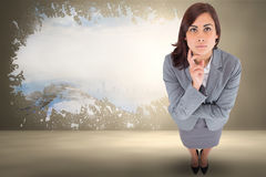 Composite image of focused businesswoman Royalty Free Stock Photo