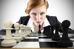 Composite image of focused businesswoman Royalty Free Stock Image
