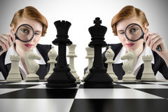 Composite image of focused businesswoman with magnifying glass Stock Photos