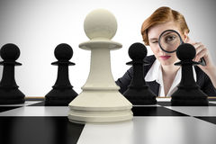 Composite image of focused businesswoman with magnifying glasses Stock Images