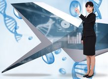 Composite image of focused businesswoman pointing Royalty Free Stock Photos