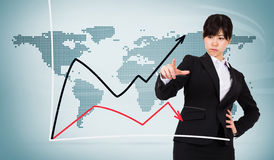 Composite image of focused businesswoman pointing Stock Photos