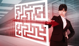 Composite image of focused businesswoman pointing Stock Photo