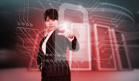 Composite image of focused businesswoman pointing Royalty Free Stock Photography