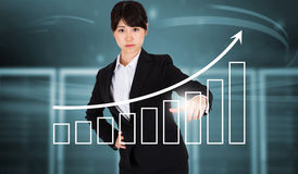 Composite image of focused businesswoman pointing Stock Photography