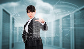 Composite image of focused businesswoman pointing Stock Image