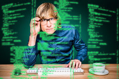 Composite image of focused hipster businessman using computer Royalty Free Stock Photography