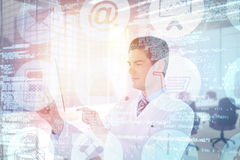 Composite image of focused male doctor using futuristic glass 3d Stock Photo