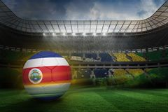 Composite image of football in costa rica colours Royalty Free Stock Photo