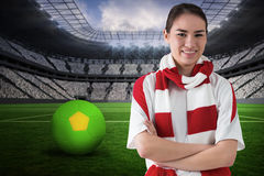 Composite image of football fan in white wearing scarf Stock Image