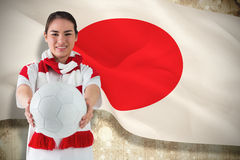 Composite image of football fan in white wearing scarf holding ball Stock Images