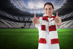 Composite image of football fan in white wearing scarf showing thumbs up Royalty Free Stock Images
