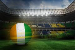 Composite image of football in ivory coast colours Royalty Free Stock Photo