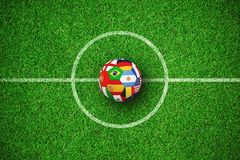 Composite image of football in multi national colours. Football in multi national colours against close up view of astro turf vector illustration