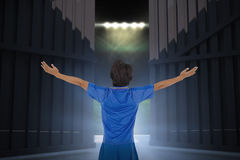 Composite image of football player celebrating with arms stretched 3d Royalty Free Stock Image