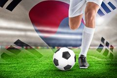 Composite image of football player. Football player against korea republic flag waving royalty free stock photography