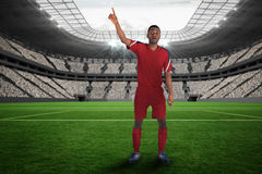Composite image of football player in red raising his hand Royalty Free Stock Photos