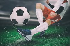 Composite image of football player in white kicking royalty free stock image