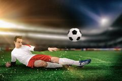 Composite image of football player in white kicking royalty free stock photography