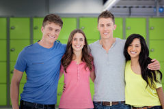 Composite image of four friends smiling and embracing each other as they look into the camera Stock Photo