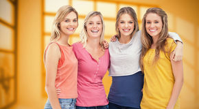 Composite image of four friends standing beside each other and smiling Stock Photography