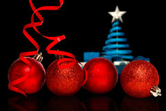 Composite image of four red christmas ball decorations Royalty Free Stock Photo