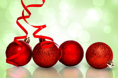 Composite image of four red christmas ball decorations Royalty Free Stock Photography