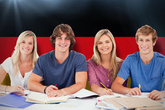 Composite image of four students looking at the camera Stock Images