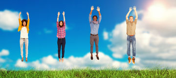 Composite image of four stylish friends smiling at the camera and jumping royalty free stock photos