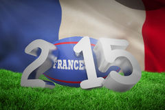 Composite image of france rugby 2015 message. France rugby 2015 message against close-up of waving france flag Royalty Free Stock Image