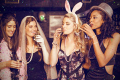 Composite image of friends celebrating bachelorette party Royalty Free Stock Images