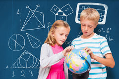 Composite image of friends looking at globe. Friends looking at globe against blackboard with copy space on wooden board Stock Photos