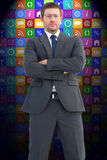 Composite image of frowning businessman looking at camera Royalty Free Stock Image