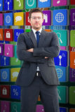 Composite image of frowning businessman looking at camera Royalty Free Stock Photography