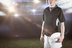 Composite image of frowning rugby player with arms crossed Royalty Free Stock Images