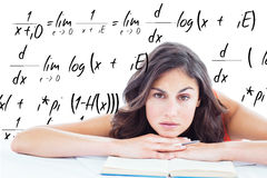 Composite image of frowning student head on her books. Frowning student head on her books against maths equation Royalty Free Stock Images