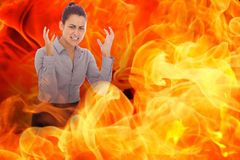 Composite image of frustrated businesswoman shouting Royalty Free Stock Photos