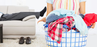 Composite image of full laundry basket Stock Images