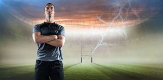 Composite image of full length of confident rugby player with arms crossed Stock Images