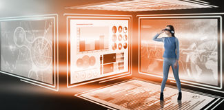 Composite image of full length of experiencing virtual reality simulator. Full length of experiencing virtual reality simulator against digital image of business Stock Image