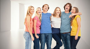 Composite image of full length of a group laughing together and looking at the camera Royalty Free Stock Images