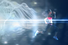 Composite image of full length of healthy woman jogging royalty free stock photo