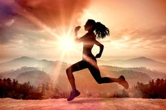 A Composite image of full length of healthy woman jogging Stock Photography