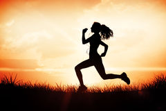 Composite image of full length of healthy woman jogging Stock Image