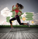 A Composite image of full length of healthy woman jogging Stock Image