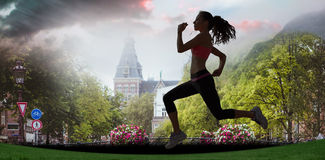 A Composite image of full length of healthy woman jogging Royalty Free Stock Photography