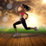 A Composite image of full length of healthy woman jogging Royalty Free Stock Image