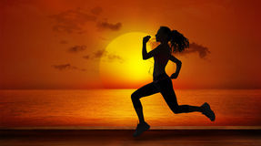A Composite image of full length of healthy woman jogging Stock Photos