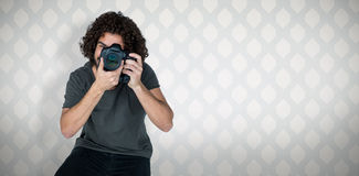 Composite image of full length of male photographer taking picture Royalty Free Stock Photos