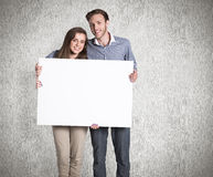 Composite image of full length portrait of couple with blank board Royalty Free Stock Photos